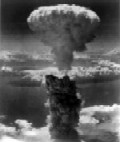 The Fat Man mushroom cloud resulting from the nuclear explosion over Nagasaki rises 18 km (11 mi, 60,000 ft) into the air from the hypocenter.